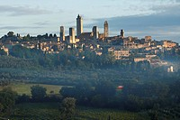 The medieval town of San Gimignano in evening light, Tuscany, Italy, Europe