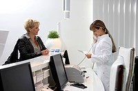 Medical practice, patient is greeted by a medical secretary