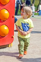 Little boy playing at the playground