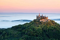 Burg Hohenzollern Castle in the morning light with autumn forests, early morning fog, Swabian Alb, Baden_Wuerttemberg, Germany, Europe