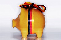 Piggy bank with ribbon in national colours, symbol image German austerity package