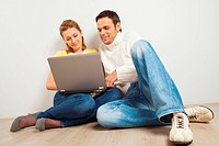 Smiling couple with laptop computer
