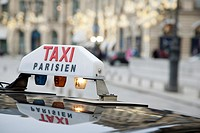 Parisian Taxi with Christmas Decoration in Background
