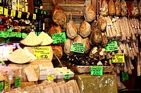 A selection of meat and cheese displayed in a Parma deli, Emilia-Romagna, Italy