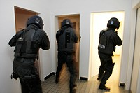 Operational rehearsal, officers of the spezialeinsatzkommando, SEK, a special response unit of the German state police force, storming the perpetrator...