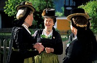 Three women in dirndl dresses talking to each other, pilgrimage to Raiten, Schleching, Chiemgau, Upper Bavaria, Bavaria, Germany