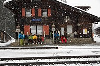 Skiers waiting for train, Cavaduerli, Klosters, Canton of Grisons, Switzerland