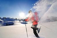 Man snowshoeing in snowy landscape, Eggenalm, Reit im Winkl, Chiemgau, Upper Bavaria, Bavaria, Germany, Europe