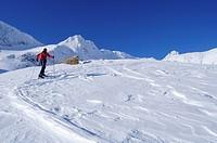 Female backcountry skier ascending to Hoher Sonnblick, Rauris valley, Goldberg mountain range, Hohe Tauern, Salzburg, Austria