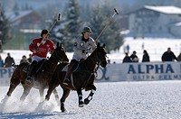 Polo players fighting for the ball, Matias Maiquez of Team Drettmann Group, chased by Marty van Scherpenzeel of Team Audi, Snow Arena Polo World Cup 2...