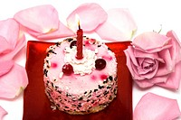 cake with candle and pink rose