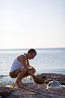 Man preparing barbeque on beach