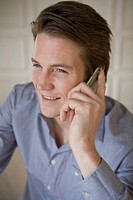 Portrait of young businessman using mobile phone