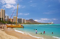 People and catamaran at Waikiki Beach, Honolulu, Oahu, Island, Hawaii, USA, America