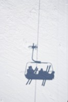 Shadow of chair lift with skiers, Disentis, Oberalp pass, Canton of Grisons, Switzerland