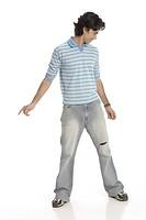 Teenage boy posing as dancing wearing t_shirt and jeans MR 687T