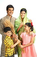 Rich Indian farmer family holding harvested golden wheat crops in hands MR743A,743B,743C,743D