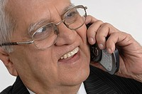 Office going South Asian Indian active old man talking on pocket pc phone MR670R