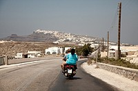 Couple on motorcycle  Santorini, Cyclades Islands, Greece