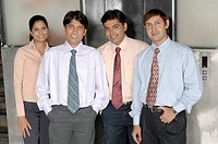 South Asian Indian businessmen and woman standing and looking at camera in office MR 670E , 670F ,670G , 670H