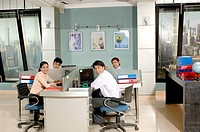 South Asian Indian businessmen and woman sitting and working in office MR 670E , 670F ,670G , 670H