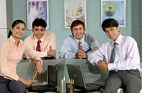 South Asian Indian businessmen and woman standing smiling and looking at camera in office MR 670E , 670F ,670G , 670H