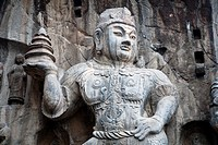 Carved statue, Fengxian Temple, Longmen Grottoes and Caves, Luoyang, Henan Province, China  Tang Dynasty
