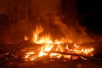 Huge bonfire burning wood fire ignited to celebrate Holi festival , Borivali , Bombay Mumbai , Maharashtra , India