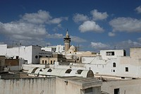 The minaret of a mosque in the Old Town or Medina of the capital of Tunis in the Norder of Tunisia in North Africa at the Mediterranean Sea.