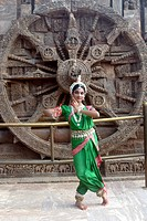Dancer performing classical traditional odissi dance at Konarak Sun temple , Konarak , Orissa , India MR 736D