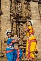 Odissi dancers strike pose re_enacts Indian myths such as Ramayana in front of world heritage Sun temple complex in Konarak , Orissa , India MR400