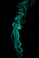 Color smoke of different shapes on black background