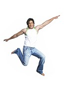 South Asian Indian man jumping with joy MR