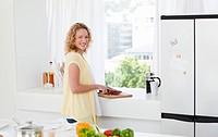 Joyful woman looking at the camera at home