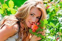 Woman smelling a rose in the garden