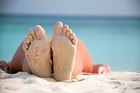 Feet on the sandy beach