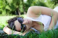 Woman lying down on grass