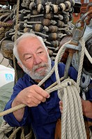 Sailor with rope and tackle on an old sailing ship