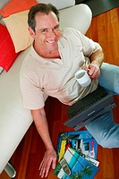 man at home with notebook
