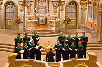 A choir performs a concert inside the Frauenkirche church, Dresden, Saxony, Germany