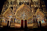 Decorative lighting at night  Ornate doorway of the Cathedral of Notre Dame, from XIII Century, in Amiens listed as World Heritage by UNESCO  It´s the...