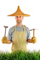 Man with Asian hat and garden tools