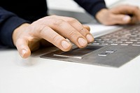 Hands using keyboard on control panel