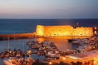 Iraklion Heraklion harbour and illuminated Venetian Fortress at night, Crete, Greece