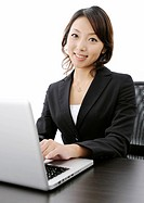 Businesswoman working on laptop