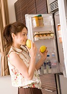 Woman selecting foods from fridge