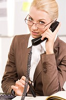 Portrait of smart agent speaking by telephone