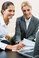 Young confident professional gives business instructions to her new specialist