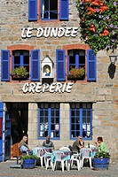 Tourists on terrace eating crepes at crêperie in Paimpol, Côtes_d´Armor, Brittany, France