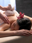 Woman on massage table with compress